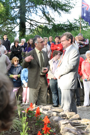 Comeraghs Comhaltas Chairman Micheál Marrinan showing the Australian Ambassador, Mr Bruce Davis around the Connery's Memorial Garden July 2012